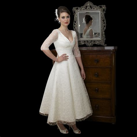 Above is a vintage lace wedding dress with tea length and sweetheart