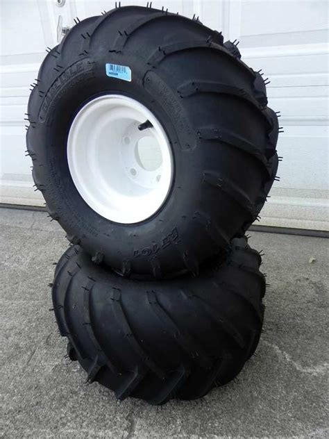 two 21 quot rawhide style tires mounted on 8 quot x8 quot bead lock