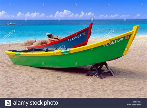 crash boat fishing brightly painted fishing boats on a caribbean beach