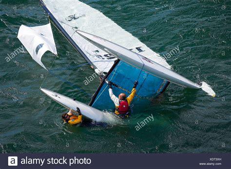 capsized cruising catamaran capsized sailboat stock photos capsized sailboat stock