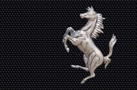 ferrari horse logo ferrari s horse logo in chrome photograph by scott lenhart