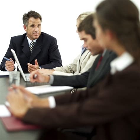 Usc Mba Mfa by Businessman Conducting A Meeting With His Staff