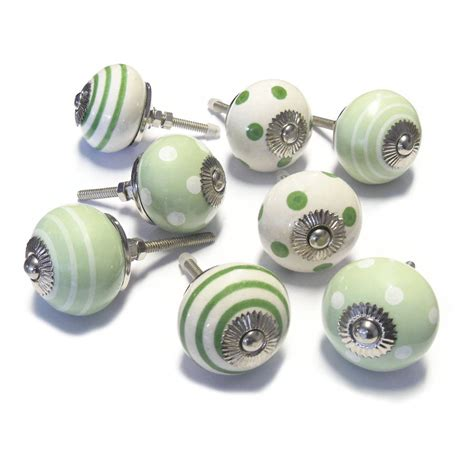 eight green and white ceramic cupboard door knobs by