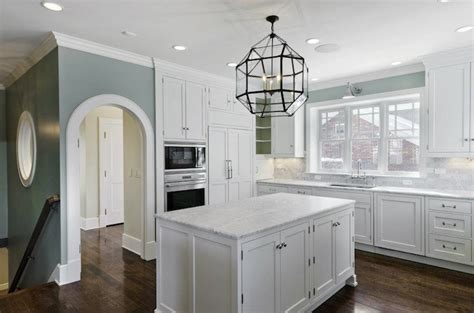 white kitchen cabinets blue walls morris pendant transitional kitchen cameo homes