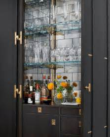 Glass Bar Cabinet Designs Stained Bar Cabinet With Mirrored Subway Tile Backsplash Contemporary Kitchen