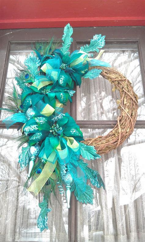 teal blue green christmas wreath with peacock feathers