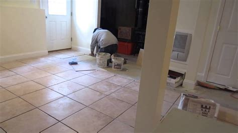 "Time lapse of a 16'x16"" ceramic tile installation on a"
