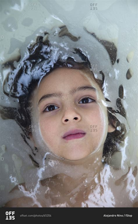 underwater in bathtub a young boy underwater in a bathtub looking serenely up