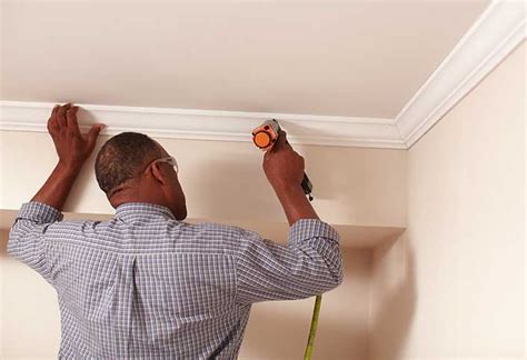 how to put up frames without nails how to install crown moulding at the home depot