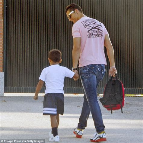 Sepatu Pink Strape cristiano ronaldo walks on school run in madrid