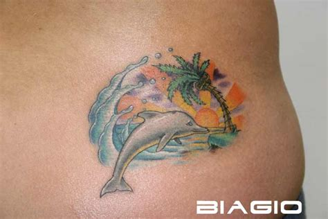 beach scene tattoo 13 dolphin lower back tattoos