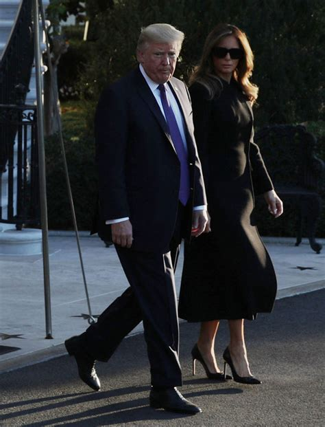 melania jacket melania flashes bare thighs in black jacket