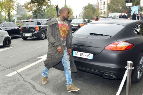 kanye west photos photos kanye west parks his porsche in
