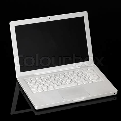Laptop Apple White studio of a white apple laptop in black reflective