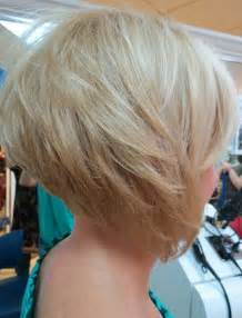 graduated layered blunt cut hairstyle side view of graduated bob cute layered platinum blonde