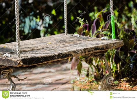 large tree swing close up old wooden vintage garden swing hanging from a