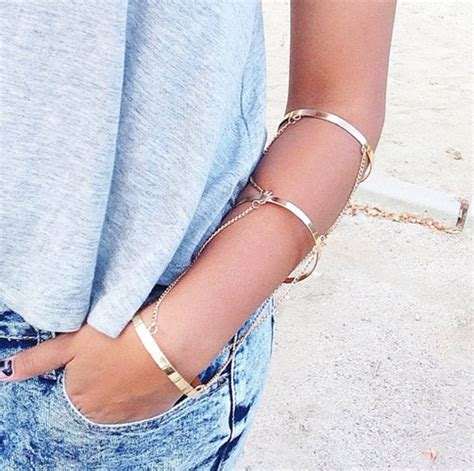 Jewels: bracelets, gold arm cuffs, god bracelets, triple chain arm cuff, arm bracelet, arm