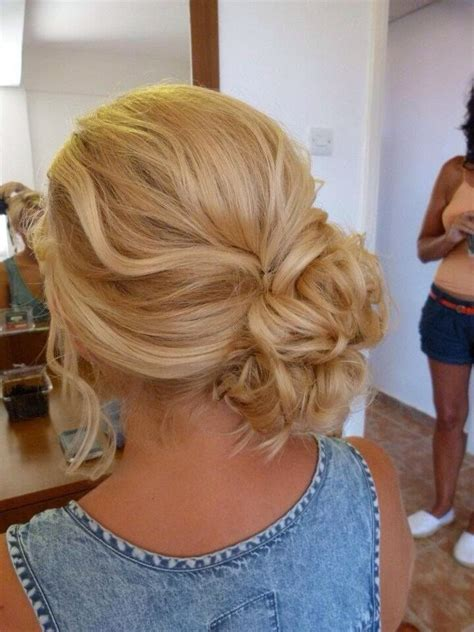 homecoming hairstyles messy bun low side swept bun prom pinterest