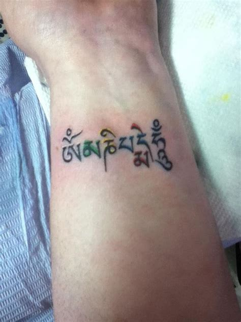 om tattoo on wrist om padme hum wrist living studios penn