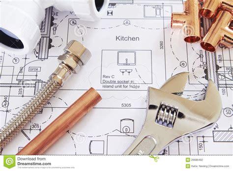 plumbing tools arranged on house plans stock photo image