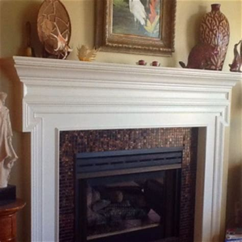 diy glass tiles around a fireplace home