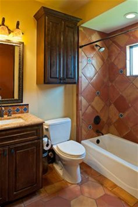 spanish tile bathroom ideas love the branded towels and the mexican style tile in the