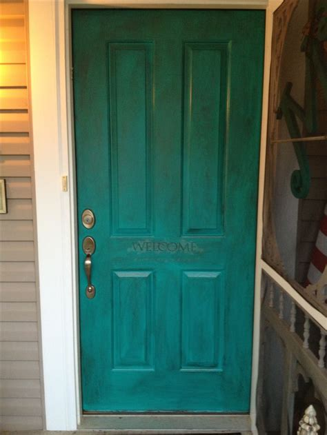 my front door painted with sherwin williams nifty turquoise and then used martha stewart s