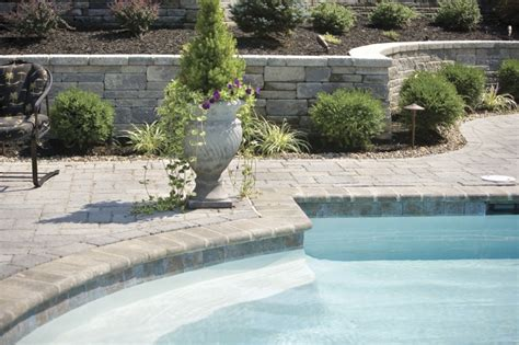 the landscaping around the swimming pool the retaining