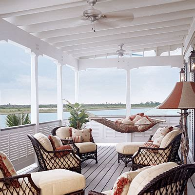 bahamas style deck with a swinging hammock and cushioned