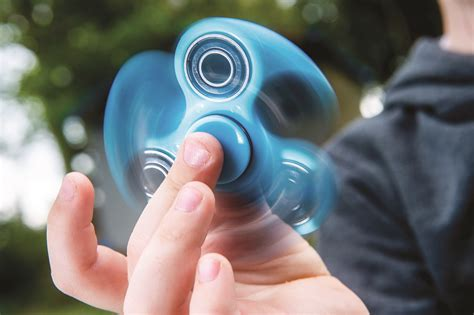 with fidget spinner fidget spinners what are they where can i buy money
