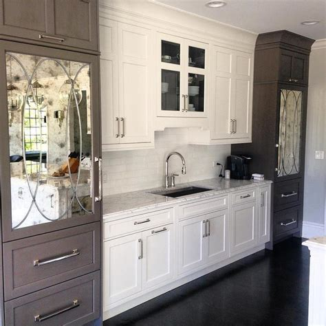 mirrored kitchen cabinets white and gray kitchen cabinets with antiqued mirrored refrigerator doors transitional kitchen