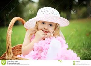 Stock photography cute girl in a beautiful dress in a basket in a
