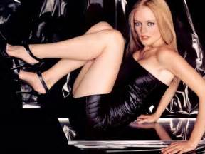 american leather sofa bed on a blue couch heather graham lying on her