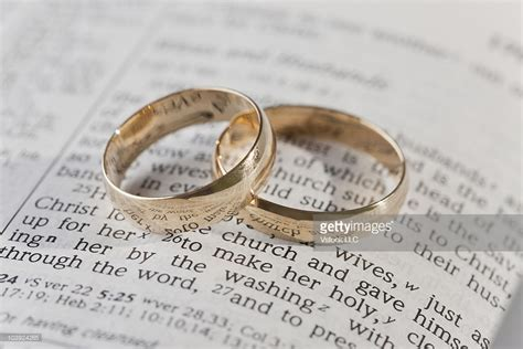 Wedding Rings On Bible by Wedding Rings On Top Of An Open Bible Stock Photo Getty