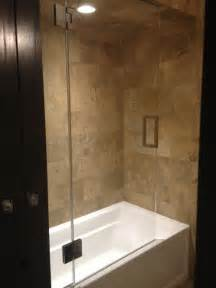 frameless shower door with splash panel for tub