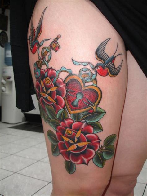 a swallow carries a key above a broken compass in this new classy tattoos heart locket tattoo