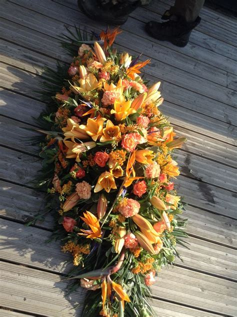 Orange Floral King Sprei orange coffin spray flowers large orange funeral spray www thefloralartstudio co uk