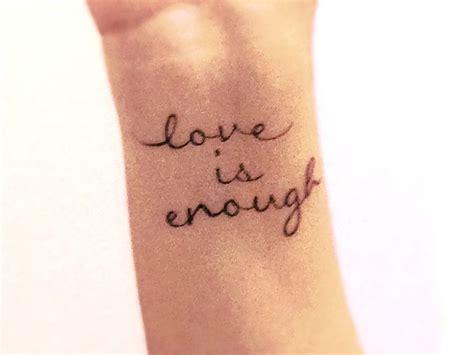 tattoo font on wrist quot love is enough quot script font wrist tattoo tattoos