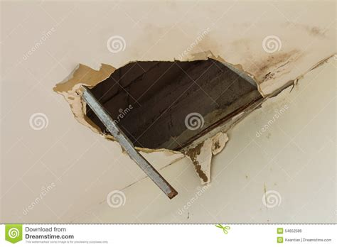 Big hole in the ceiling stock photo. Image of home, leaky