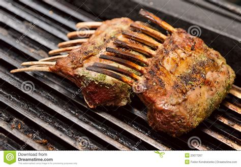 rack of lamb on grill rack of lamb on grill royalty free stock photography