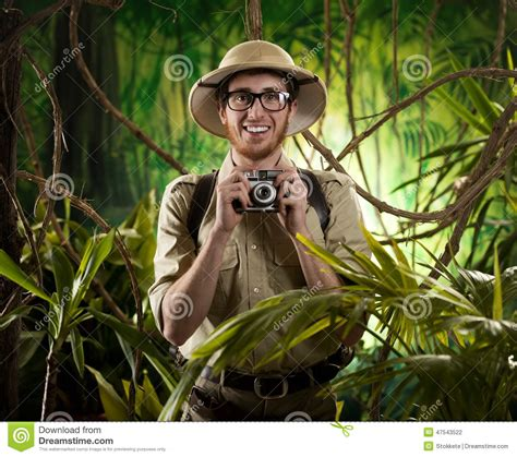 1431702064 on safari a young explorer s young photographer in the jungle stock photo image 47543522