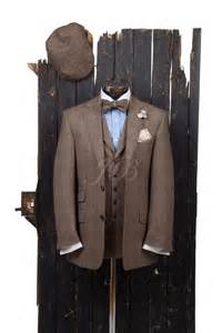 brown country suit with bow tie flat cap from