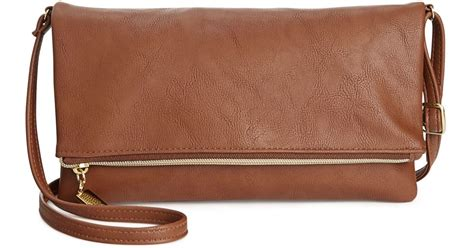 style co tunnel crossbody in brown save 42 lyst