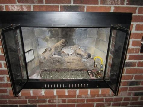 some questions help with my b vent gas log fireplace