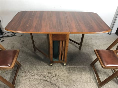 modernist suitcase dining table fold  compact