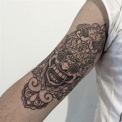 tattoo bali mask 16 fabulous balinese mask tattoos tattoodo