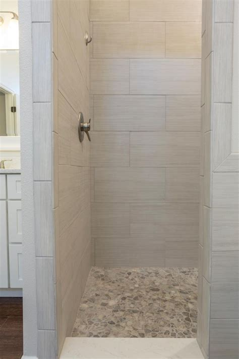 shower with gray subway tiles transitional bathroom bathroom beige pebble shower floor pictures decorations
