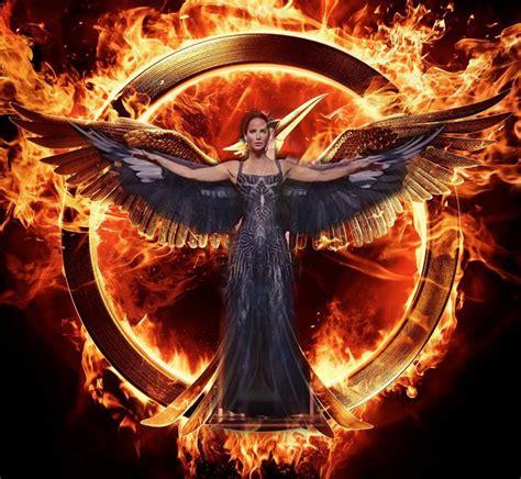 The Hunger Mockingjay mockingjay part i poster mimics katniss s dress