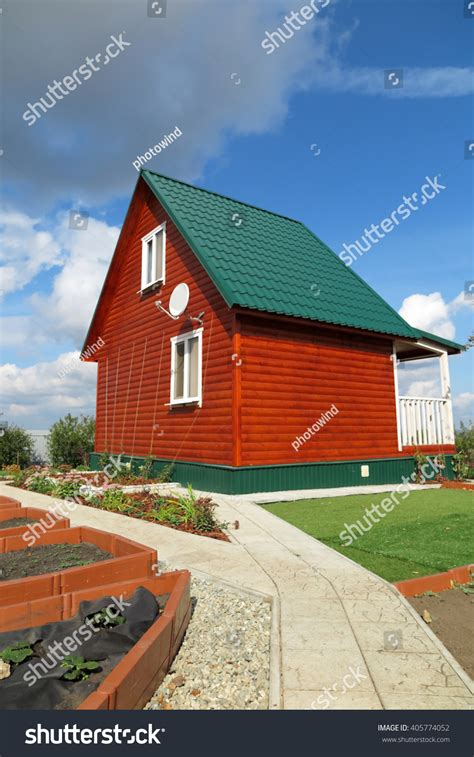 Summer Cottages by Modern Summer Cottage Against Blue Sky Stock Photo