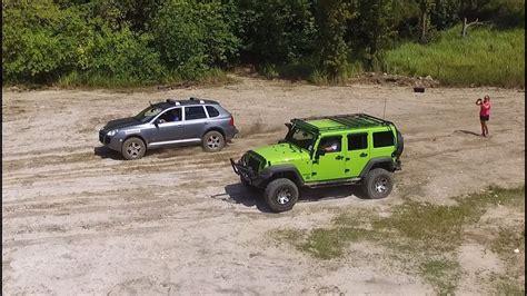porsche jeep jeep vs porsche cayenne turbo hill climb rock